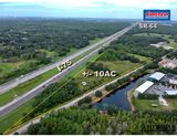 DIVISIBLE: +/- 10 acres on Lena Road with over 1000ft of I-75 frontage