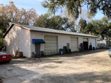 1.84 Acres w/ 3600 sf warehouse and 3 homes